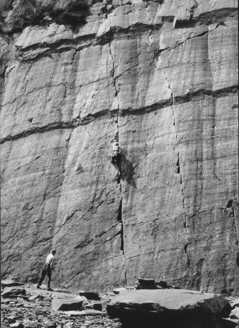 A climber on the Stempstress Slab in Morgan