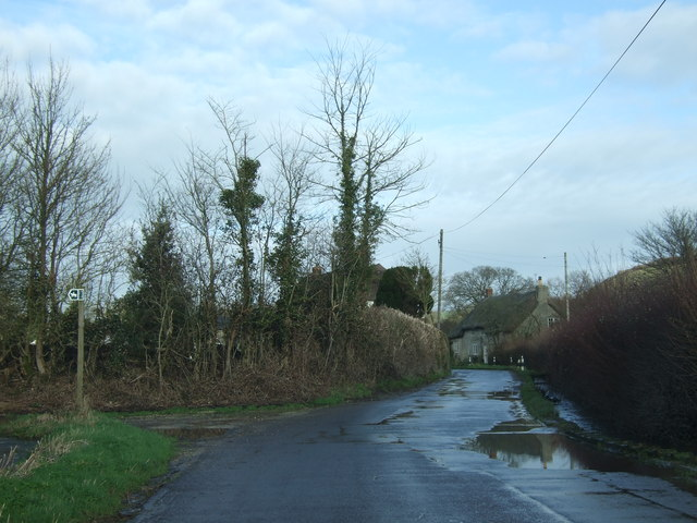 Road into Sydling St Nicholas with stream alongside