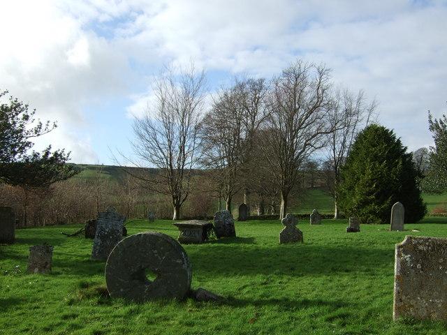 Millstone grave marker in Sydling St Nicholas churchyard