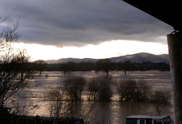 The Severn in flood under the Carrington bridge