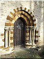 SP9263 : St Michael's Church Doorway at Farndish by Nigel Stickells
