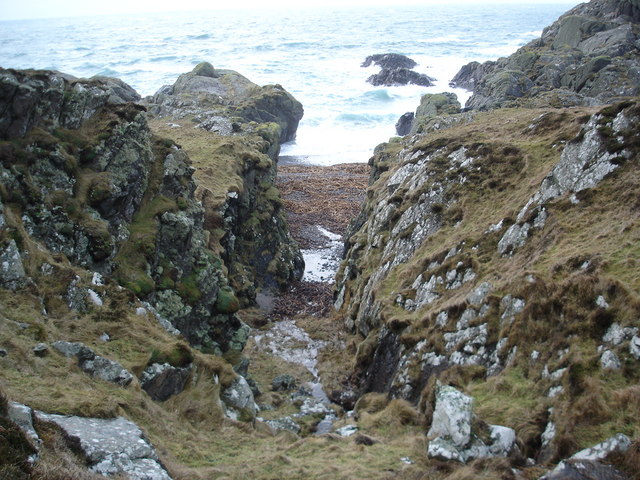 Little gulley leading to a pebble beach