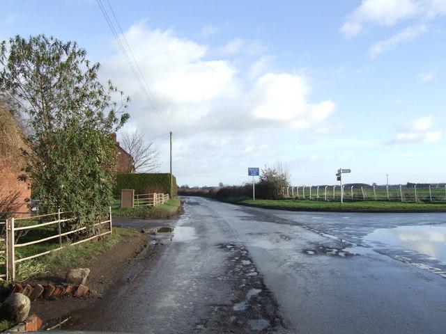 Road junction by Little Brampton