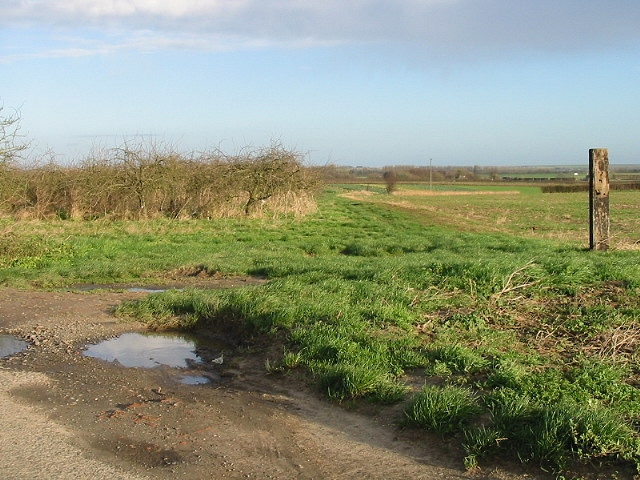 Orchard, farmland and bridleway to right.