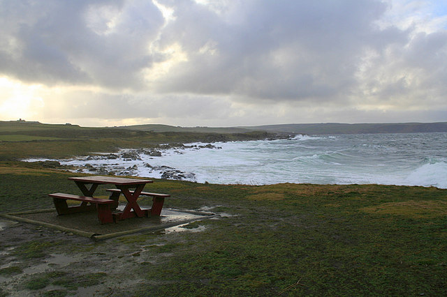 An empty picnic table overlooking Lochielair Bay.