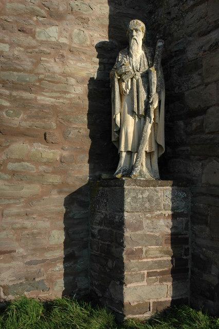 Statue below the tower of Bridge Sollers church