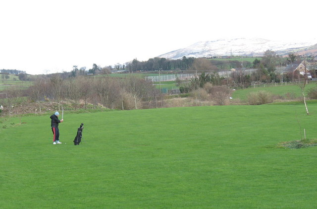 Golfer braves the cold weather at the Tyddyn Mawr Course