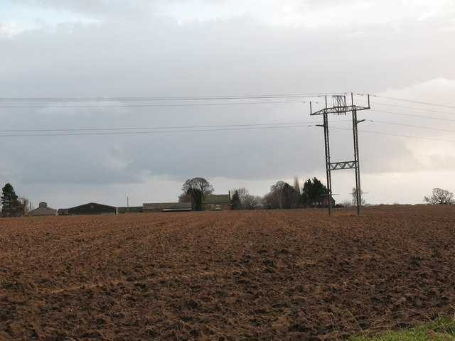 Ploughed fields and pylons near Treble Sykes Farm.