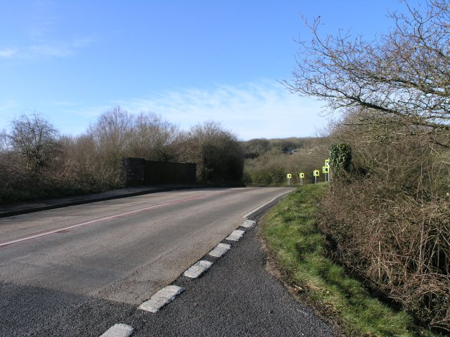 Road bridge over disused railway line