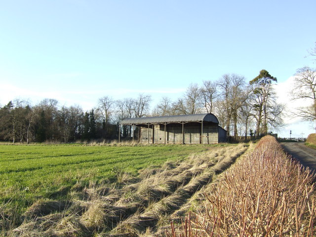 Barn backed by woodland