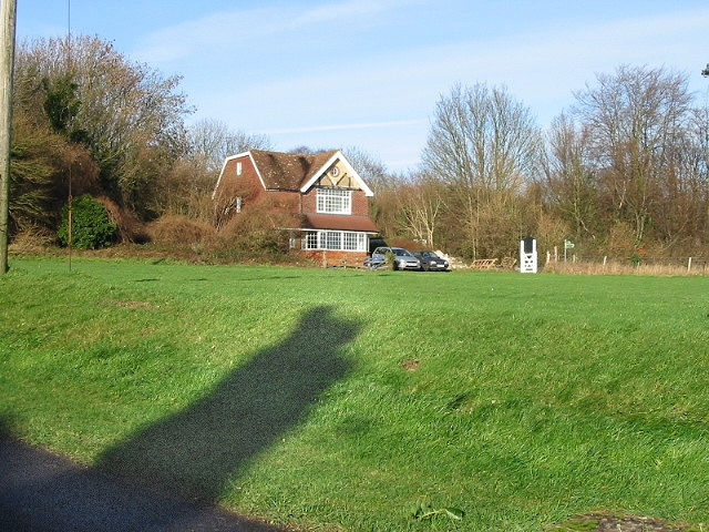 House overlooking village green, Woolage Village