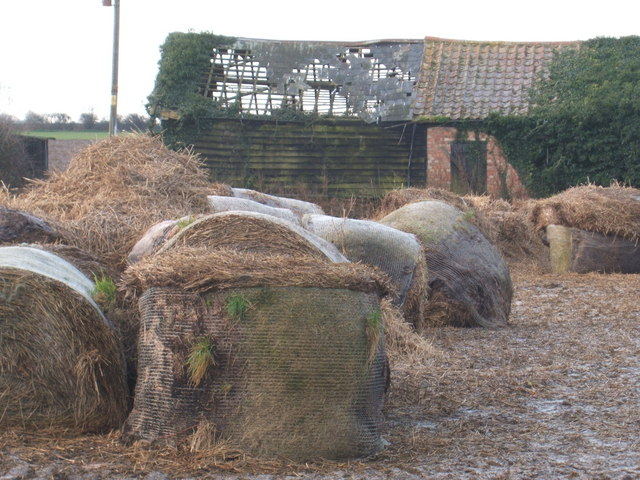 Derelict barn and old bales, west of Wicken
