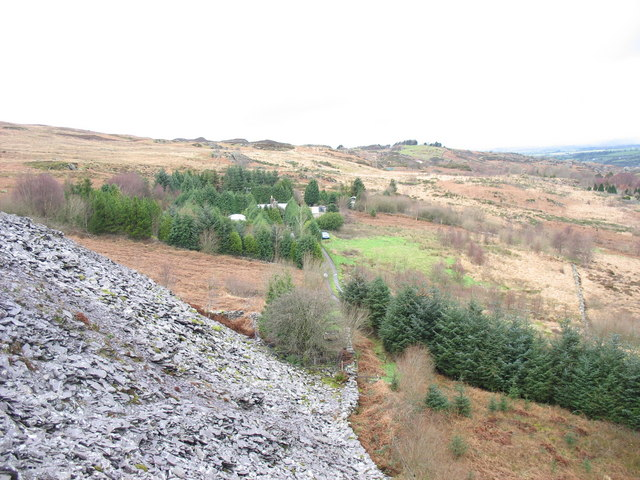 View along the path towards , and beyond, Clegyr from the old reduction level of Cook Quarry