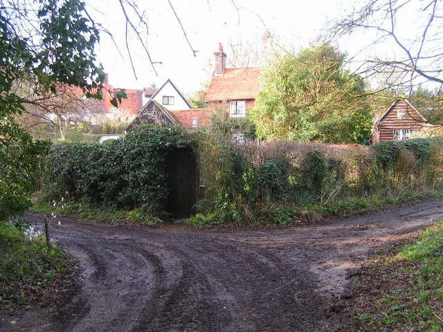 Houses at junction of  lane to ford at Hanging Wood