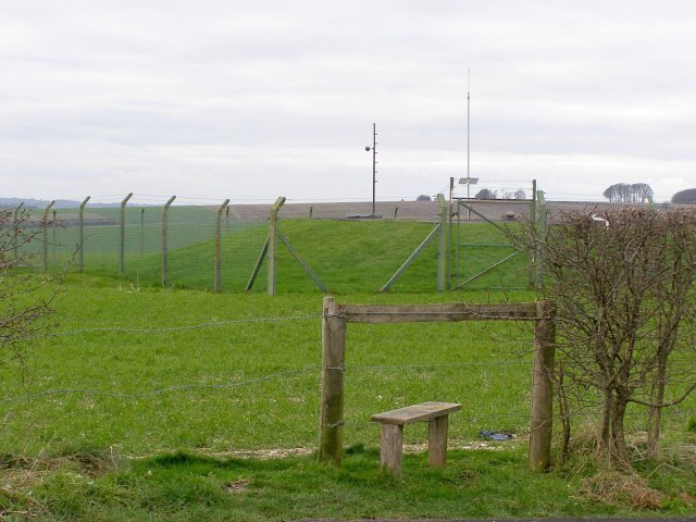 Stile and covered reservoir, Lane End Down