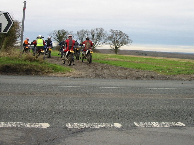 Motorcyclists setting off along byway at Aylesham Corner.