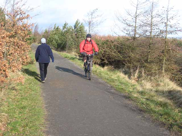Walker and cyclist on the Deerness Valley Path
