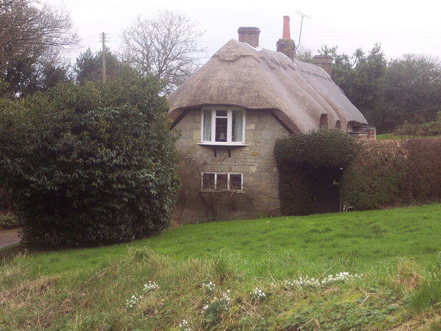 The Green and Thatched Cottage at Gutch Common