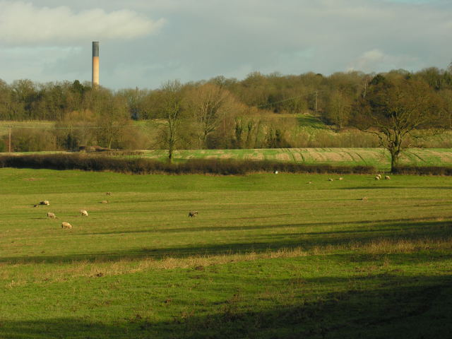 View across fields with unidentified chimney in distance