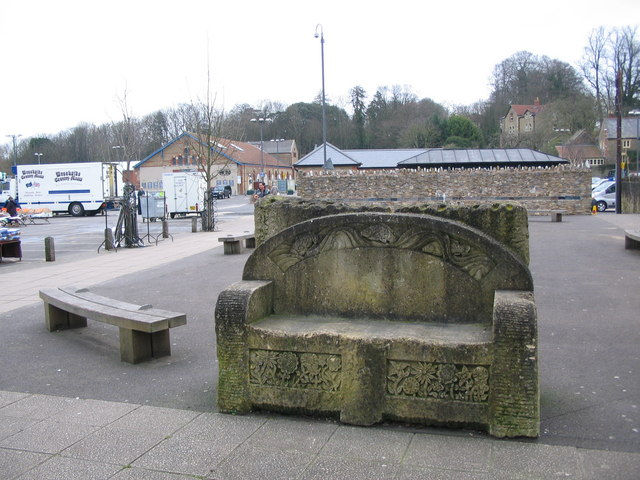Carved stone seat adjacent to Frome library