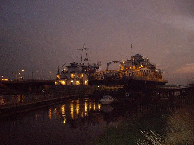 Cargo boat passing Cross Keys Bridge