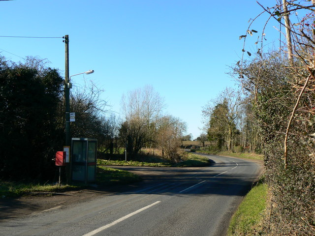 Postbox, phone box and bus stop, West Grafton, Wiltshire