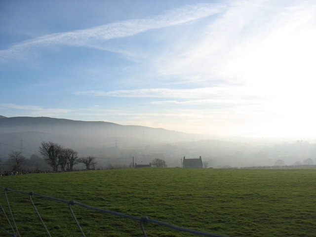 Houses at the top of Allt Pont-rhythallt viewed from Pen-y-gaer as the fog begins to move in from the sea