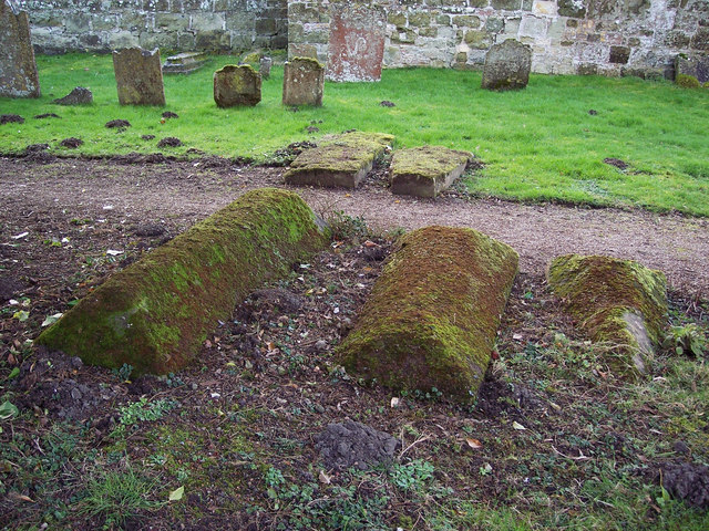 Lichen covered tombs in St Michaels Churchyard