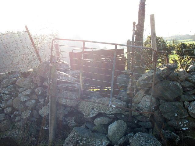 Double gates on stile at farm boundary