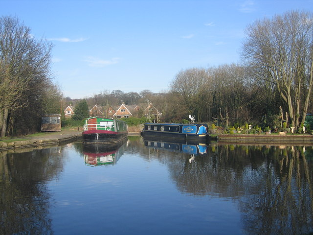 Barges moored alongside the Leeds and Liverpool Canal
