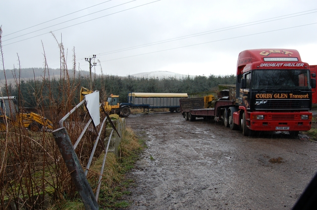 Vehicle yard by the River Deveron