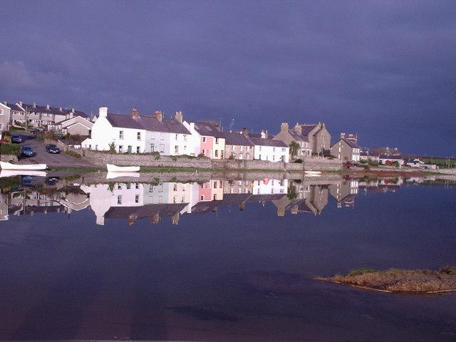 Riverside Cottages on the Afon Ffraw at high November tide