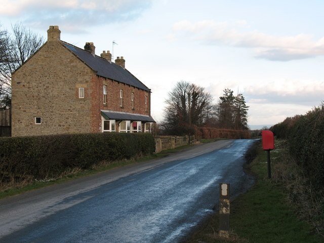Cottages and postbox by country lane.