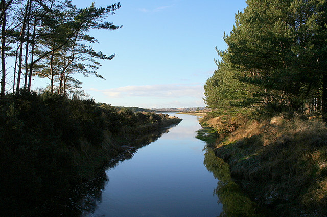 Looking along the Innes Canal with Lossiemouth on the horizon.