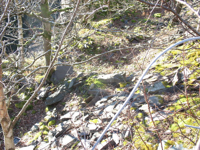 A glimpse through the security fence into the middle pit of Lower Glynrhonwy Quarry