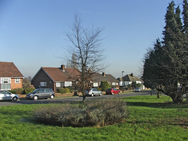 Green at top of Lakenheath at junction with Chase Road, Gerrards Close maisonettes in the background.