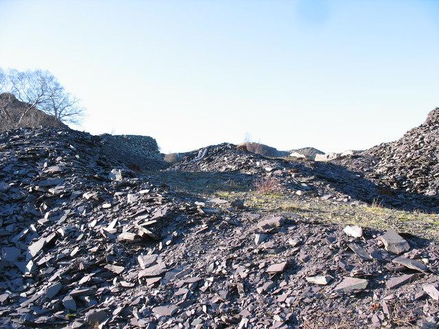 Track along  the lower rubbish runs of Upper Glynrhonwy Quarry