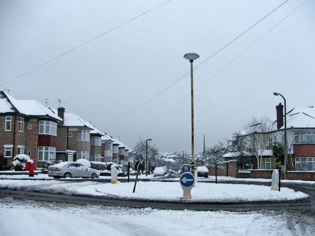 Roundabout at cross roads of Merrivale and Sheringham Avenue, N14