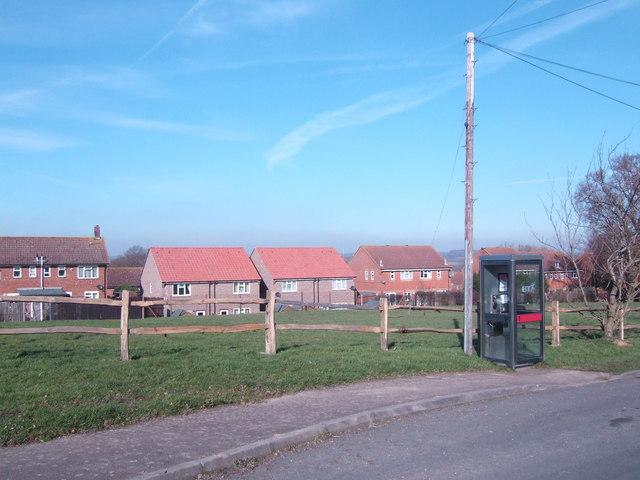 Phone box and village housing, Burwash