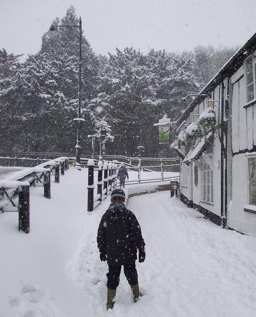 The Robin Hood  and snowy footpath