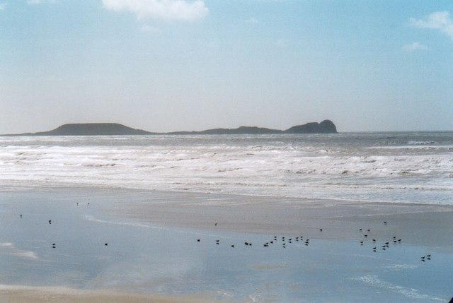 Sandy beach and waders. Rhossili Bay