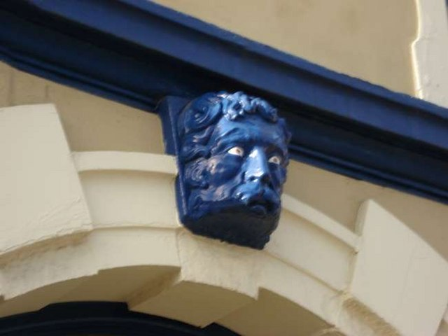 Face over entrance arch to pottery works