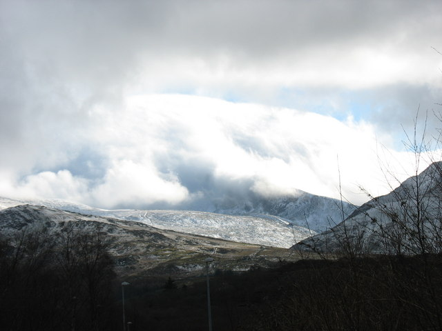Clouds spilling over Snowdon viewed from Glynrhonwy