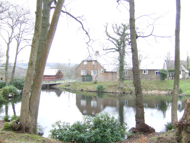 Pond and house in the Weald