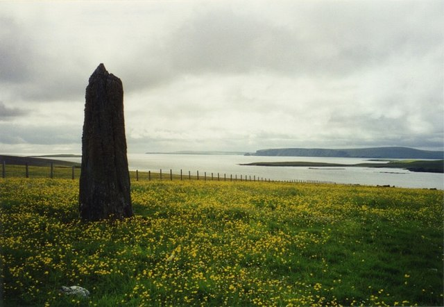 Clivocast standing stone with Fetlar on the horizon