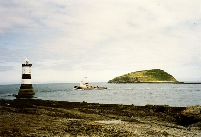 Tugboat negotiating passage between Penmon Point and Puffin Island