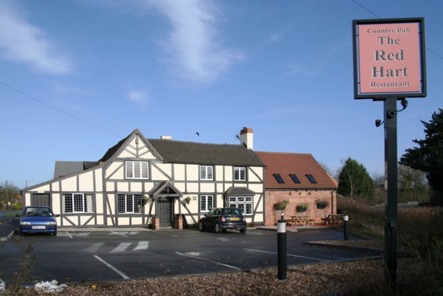 The Red Hart Public House at the junction of the A422 and Cockshot Lane, Dormston