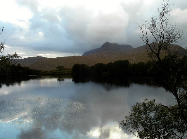 Roadside loch reflecting Ben More Coigach