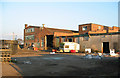 SJ6047 : Disused factory, by Wrenbury Station by Espresso Addict