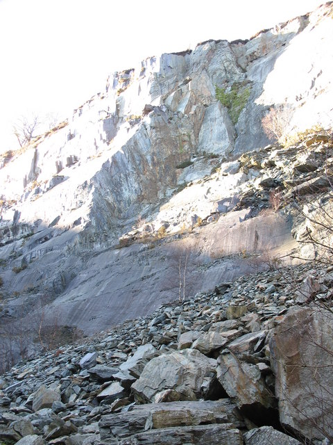 Boulder-skirted NW wall of the upper pit of Glynrhonwy Lower Quarry